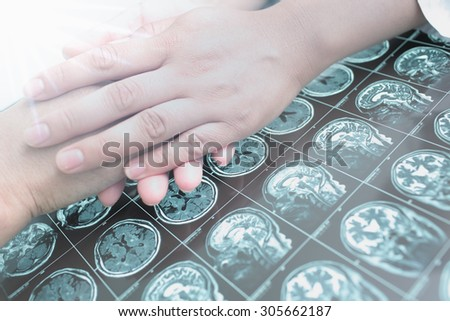 Doctor gives hope to seriously ill patient - stock photo