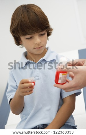 Doctor giving medicine to little boy - stock photo