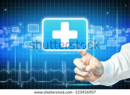 Doctor hand touching first aid sign - stock photo