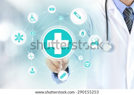 Doctor hand touching first aid sign on virtual screen - healthcare and medical concepts - stock photo