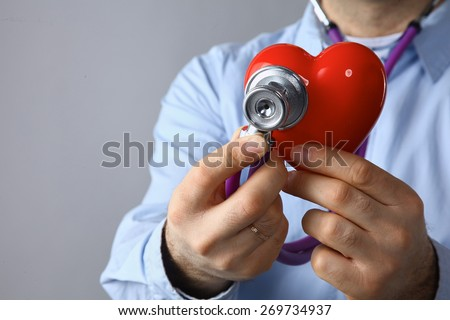Doctor  hands with heart - stock photo