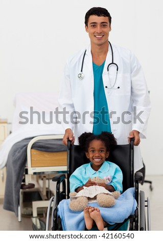 Doctor helping a young child in a hospital - stock photo