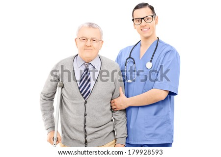 Doctor helping an elderly gentleman with crutch isolated on white background - stock photo