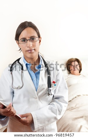 Doctor holding a cardboard with exams with a senior patient in the background - stock photo