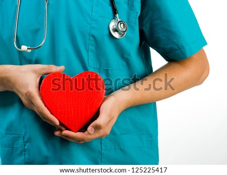 doctor holding a heart symbol  on white background - stock photo