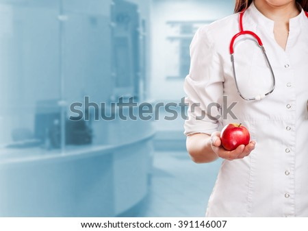 doctor holding apple - stock photo