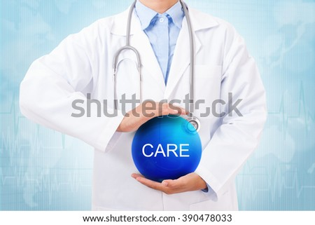 Doctor holding blue crystal ball with care sign on medical background. - stock photo