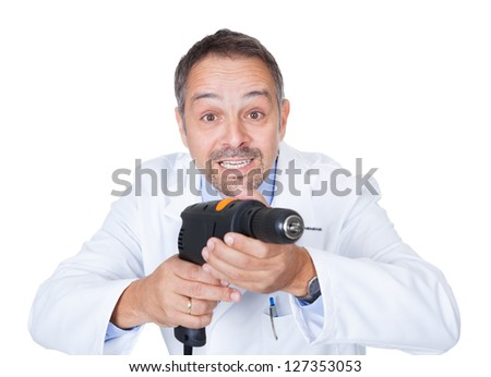Doctor Holding Drill Machine On White Background - stock photo