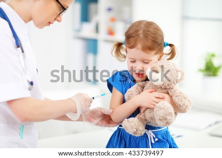 Doctor holds an injection vaccination the child - stock photo