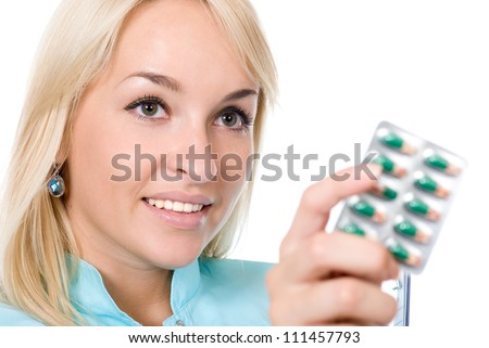 Doctor holds packing of tablets.isolated over white - stock photo