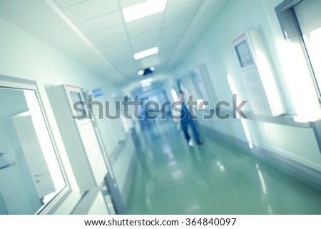Doctor hurries for help along the long hospital corridor, blur. - stock photo