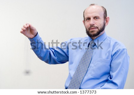 Doctor hypnotizing you, hand and watches blured in motion - stock photo