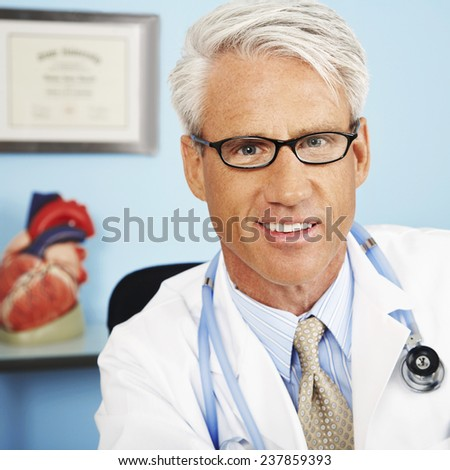 Doctor in Office - stock photo