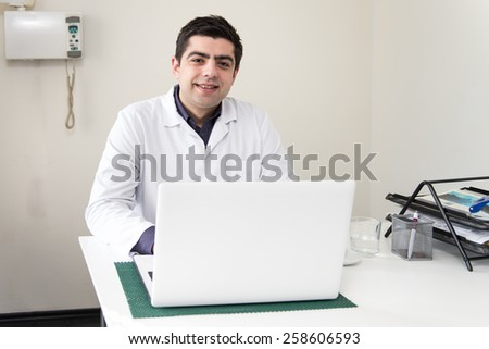 Doctor In The Dentist Office With Laptop - stock photo
