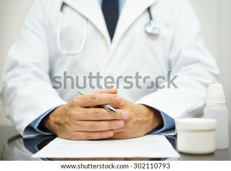 Doctor is listening his client about health issues - stock photo