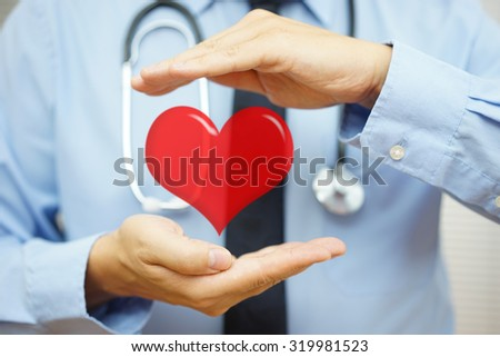 doctor is protecting heart  with hands. Health care and  Cardiovascular diseases  concept - stock photo
