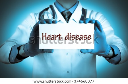 Doctor keeps a card with the name of the diagnosis - heart disease. Selective focus. Medical concept. - stock photo