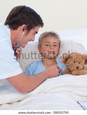 Doctor listening to a child chest with stethoscope in bed - stock photo