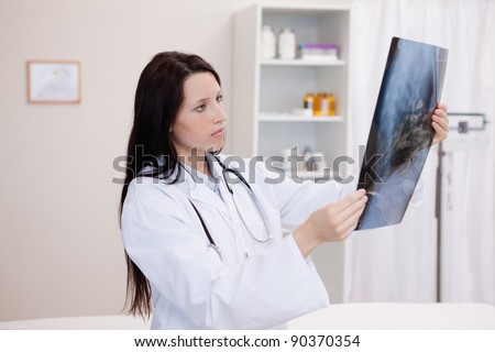 Doctor looking at a set of X-ray in a hospital - stock photo