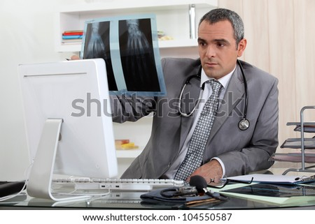 Doctor looking at X - stock photo