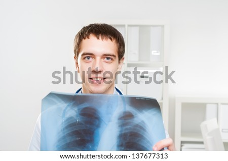 Doctor looking the x-ray picture of the chest - stock photo