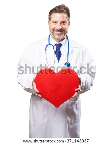 doctor man holding a heart - stock photo