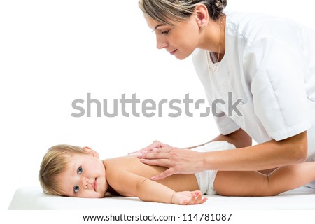 doctor massaging or doing gymnastics baby girl - stock photo