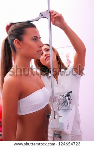 doctor measuring patients height - stock photo