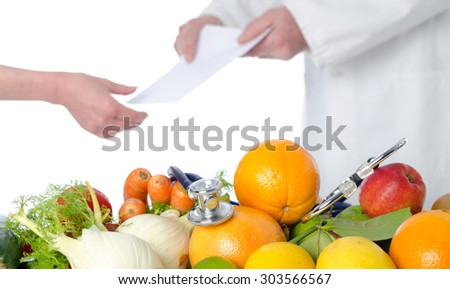 Doctor nutritionist in office giving a diet plan to his patient - stock photo