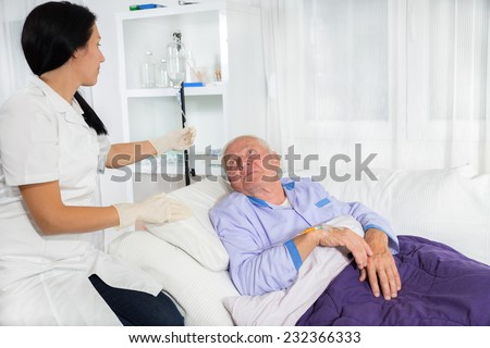 doctor or nurse includes infusion patient in hospital - stock photo