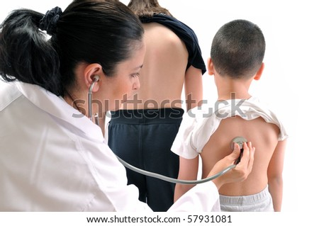 Doctor pediatrician examines little child using stethoscope while his sister waiting for her term - MEDICAL IMAGES. - stock photo