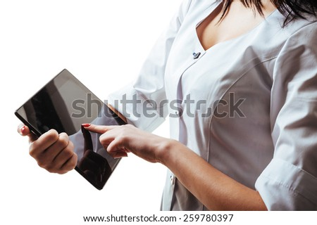 Doctor pointing on tablet PC. Close-up of female doctor using digital tablet. - stock photo