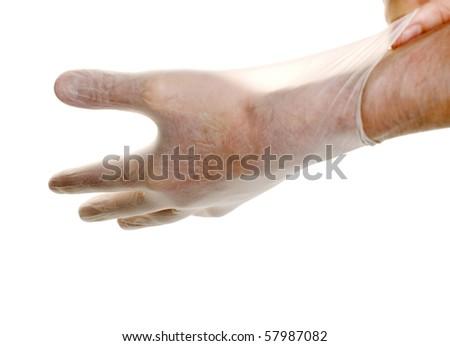 Doctor pulling on surgical glove isolated over white - stock photo