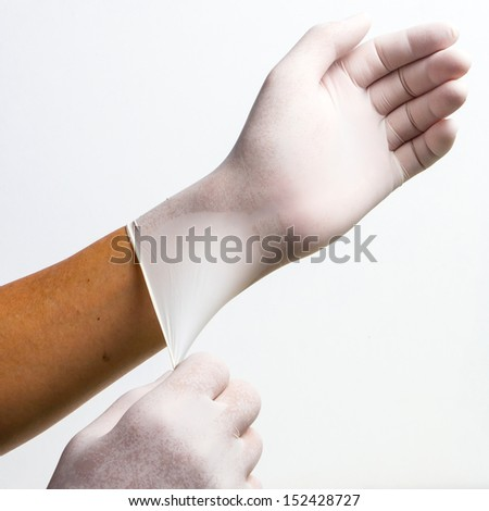 Doctor put gloves for operation - stock photo