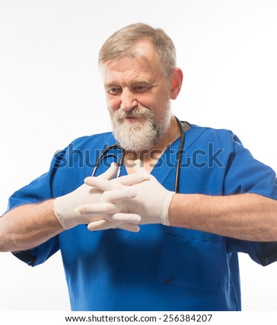 Doctor puts gloves - stock photo