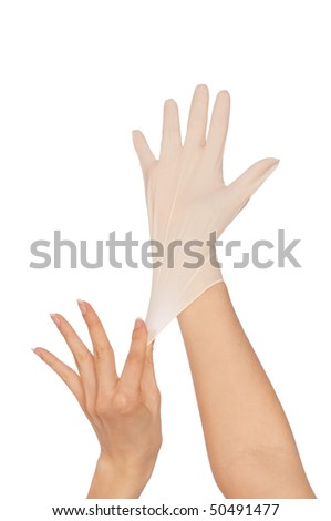 doctor putting on white sterilized medical glove for making operation - stock photo