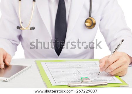 Doctor record history or filling medical form. - stock photo