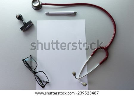 Doctor's desk desk medical concept with a copy space on the paper. - stock photo