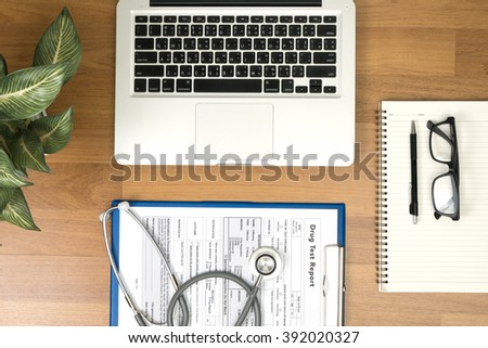 Doctor's desk in table Top view of modern, sterile doctors office desk. Medical - stock photo