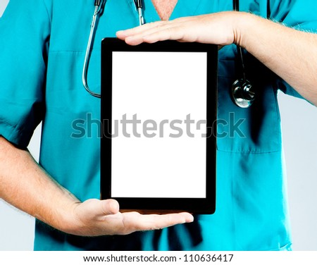 doctor's hands hold the tablet vertically - stock photo