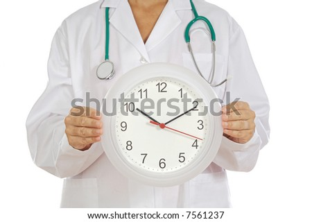 Doctor«s hands showing clock over white background - stock photo