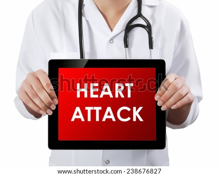 Doctor showing tablet with HEART ATTACK text.  - stock photo