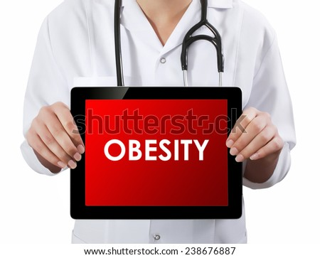 Doctor showing tablet with OBESITY text.  - stock photo