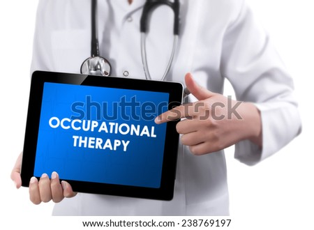 Doctor showing tablet with OCCUPATIONAL THERAPY text.  - stock photo