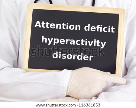 Doctor shows information: attention deficit hyperactivity disorder - stock photo