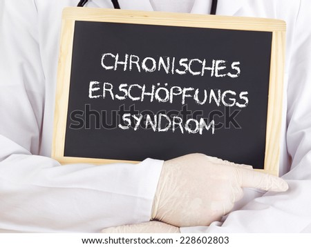 Doctor shows information: chronic fatigue syndrome in german - stock photo
