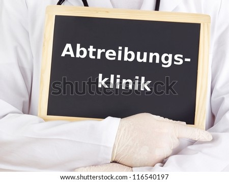 Doctor shows information on blackboard: abortion clinic - stock photo