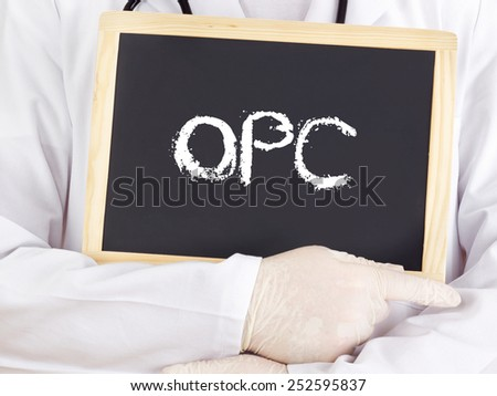 Doctor shows information on blackboard: OPC - stock photo