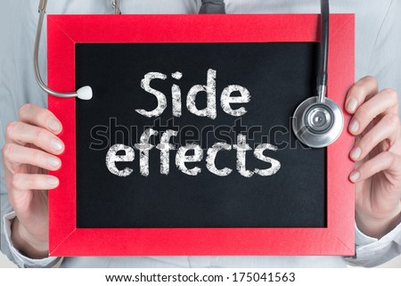 Doctor shows information on blackboard: side effects  - stock photo