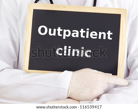 Doctor shows information: outpatient clinic - stock photo